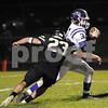 Griffin Nelson of Sycamore chases down Rochelle quarterback Andrew Johnson Friday night.<br /> Steve Bittinger - For Shaw Media