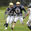 Hiawatha running back Austin Sunderlage follows blocker Jacob Smith in first half action on Saturday.  Steve Bittinger - For Shaw Media