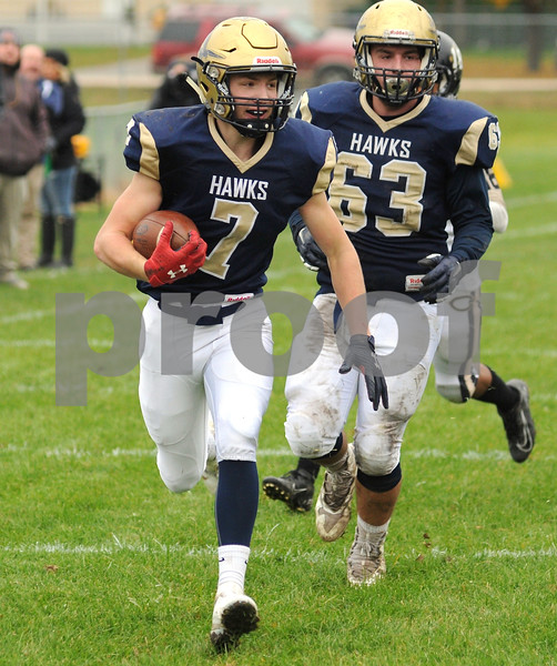 Ty Kilcullen heads for the end zone and a first half touchdown for Hiawatha on Saturday in Kirkland.  Steve Bittinger - For Shaw Media