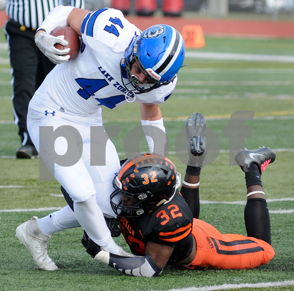 DeKalb defensive back Donovan Lacey takes down a Lake Zurich ball carrier during playoff action Saturday in DeKalb.  Steve Bittinger - For Shaw Media