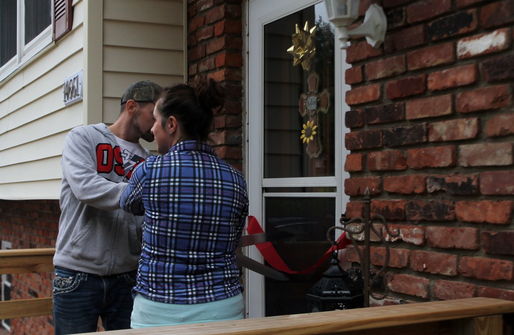 . Kristi Garabrandt - The News-Herald  Bryan and Heather cut the ribbon to their newly completed house during the Oct. 29 dedication.