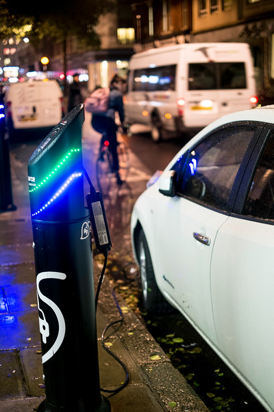 Electric car being charged on the street, London, United Kingdom