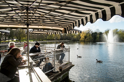 Terrace cafe overlooking the lake with a fountain, Victoria Park, Hackney, London, United Kingdom