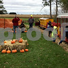 Children collect pumpkins during a stop by the Pumpkin Train on Saturday in Lions Community Park in Waterman.