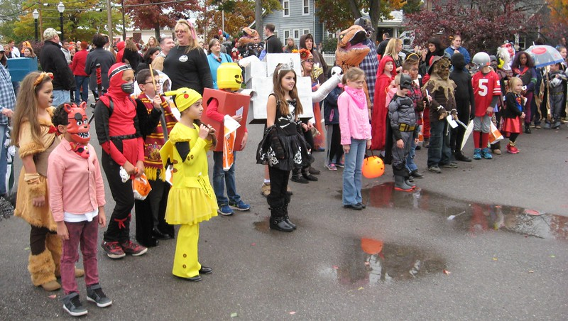 Richard Payerchin - The Morning Journal <br> Youths line up for judging on Oct. 30, 2016, before they walk in the annual Halloween Parade and Costume Contest, sponsored by the Amherst Fire Department. Weather was cool but rain stayed in the clouds, so hundreds of youths and families came out for the event.