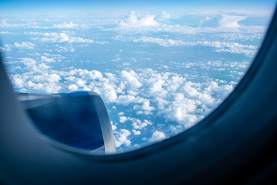 View from a window seat, passenger airplane, clouds and sky
