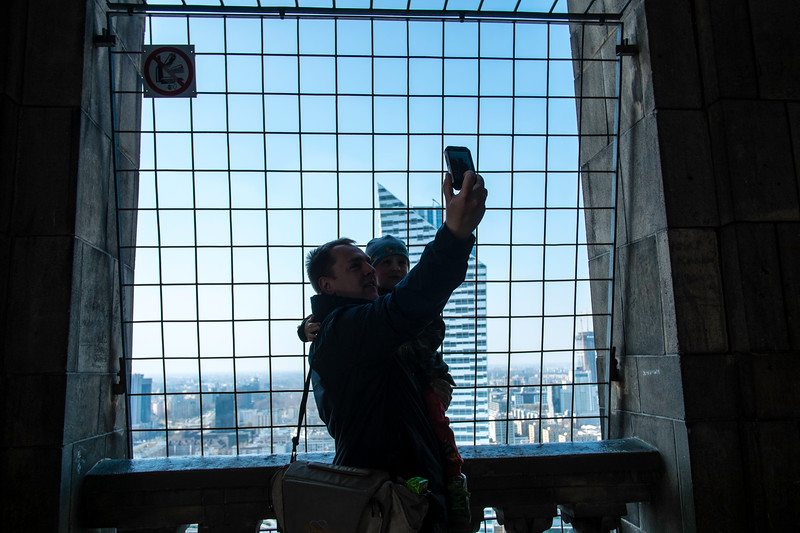 Tourists at viewing gallery of Palace of Culture and Science, Warsaw, Poland