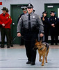 HOLLY PELCZYNSKI - BENNINGTON BANNER Robert Murawski and K-9 Gracie walk side be side during graduation on Friday at the Vermont Criminal Justice Training school in Pittsford Vermont.