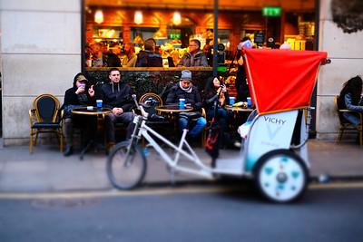 Rickshaw on the sidewalk, Soho, London, United Kingdom