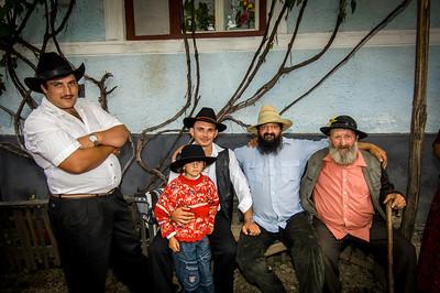 Europe, Romania, Transylvania, Gypsy wedding,  Roma men at wedding party at bride's home