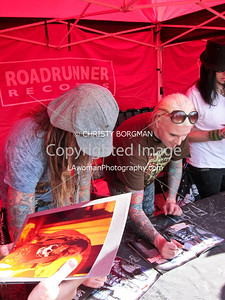 Rob Zombie, John 5 and Piggy D.  Woman working the signing is holding the photo I took of Rob at the Hollywood Palladium last October.