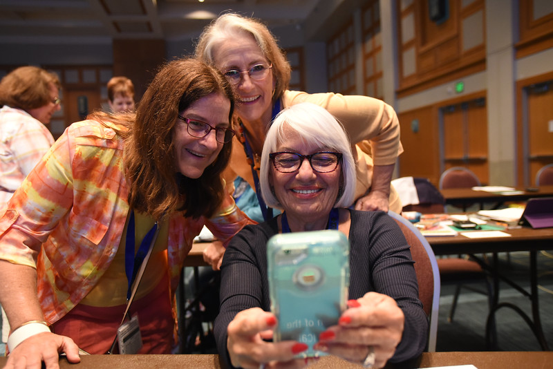 Tenth Triennial Convention | Pictured left, Dawn Smith, Midland, Mich., St. Timothy Lutheran Church, Carol Swackhammer, Edmont, Wash., Edmont Lutheran Church, pose for a selfie taken by Lisette Martinez, Carolina, Puerto Rico, Cristo Rey.