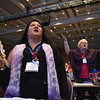Tenth Triennial Convention | Tina Bigelow, Poulsbo, Wash., Vinland Lutheran Church and Lisa Youngquist, Ozark, Mo., Messiah Lutheran, Springfield, raise their arms in song.