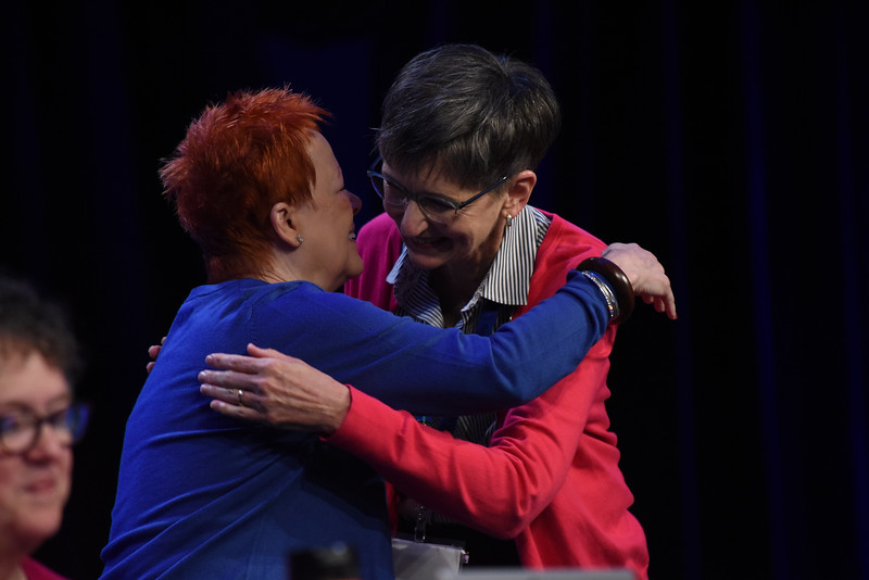 Tenth Triennial Convention |  Patti Austin embraces Becky Shurson after Becky is elected as vice president of the 2017-2020 board.