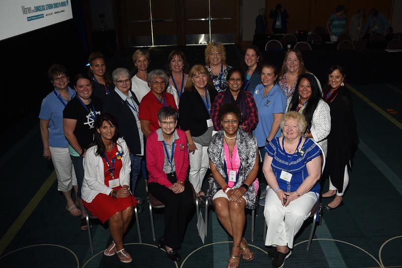 Tenth Triennial Convention | The newly elected 2017–2020 Women of the ELCA Executive Board. <br /> <br /> <br /> Row 1: Lisa Plorin, president (left); Becky Shurson, vice president; Freddie Jordan, secretary; Anna Sarver, treasurer. Row 2: Angela Bell (left), Elizabeth Burgess, Lydia Davila, Karen Voris, Rev Dinah Dutta, Anissa Canova, Tina Bigelow, Keala Simoes. Row 3: Lois Bylund (left), Sara Larson, Barbara Tormondsen, Kandy Pflaster, Sandra Grier, Joy Michalicek, Laura Kruegar. Not pictured: Viviane Thomas-Breitfeld, Lynette Todd.