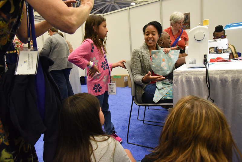 Tenth Triennial Gathering | Keia Morris, Gardena, Ca., Another Level Ministries, teaches girls from Mt. Iron, Minn. Messiah Lutheran, about making kits for Days for Girls.