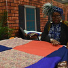 Tenth Triennial Gathering | Trish Williams, Peoria, Il., St. Paul Baptist Church, cuts the fabric for making quilts.