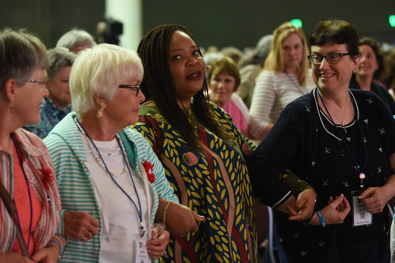 Tenth Triennial Gathering | Leymah Gbowee encouraged women to join hands after her talk.