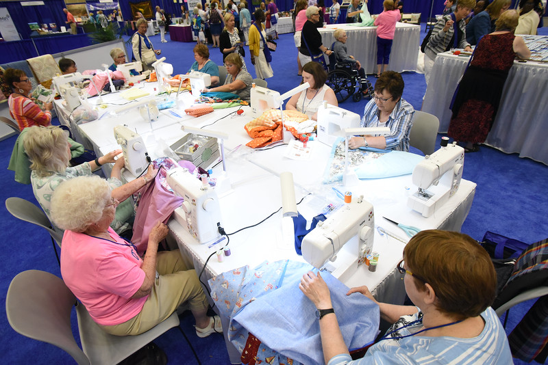 Tenth Triennial Gathering | Quilters at the servant events area of the exhibit hall.