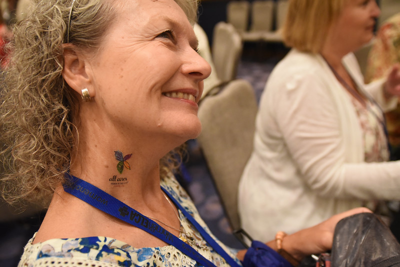 "Tenth Triennial Gathering |  ""All anew"" neck tattoo at the first-time breakfast."