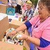 Tenth Triennial Gathering | Patty Grieve, Georgetown, Texas, Christ Lutheran, counts hygiene items for In-kind gifts.