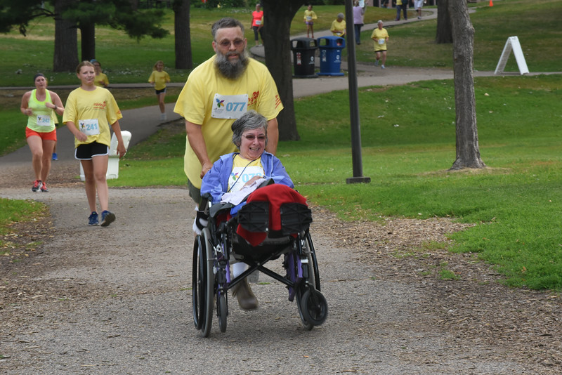 Tenth Triennial Gathering | Mary Ann and Jeff Dittmeier, Holtsuicle, N.Y., Our Saviors Lutheran Church, take part in the Run, Walk and Roll.