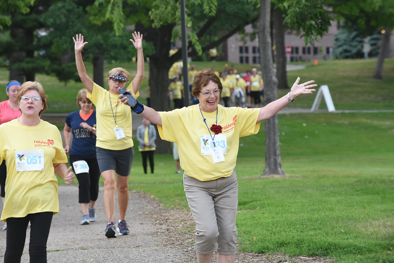 Tenth Triennial Gathering |  Betty Brandt, Hutchinson, Minn., River of Hope Lutheran church raises her hands before embarking on lap two in Loring Park.