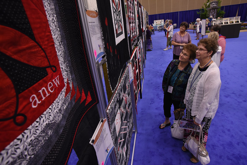 Tenth Triennial Gathering | (left) Judy Wormstad, and Jean Wormstadt, Artesian, S.D., First Lutheran Church view quilts in the exhibit hall.