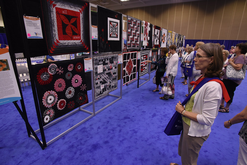 Tenth Triennial Gathering | Yvonne Andrews, Omaha, Neb., Rejoice Lutheran Church, views the quilts from the quilting challenge.