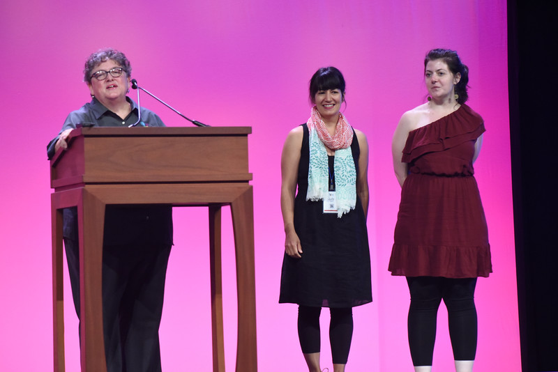 """Tenth Triennial Gathering   Linda Bushkofsky introduces the designer, Judy Higgins and Alli Luhmann, the glass blower who creates the """"All Anew"""" communion ware to the audience."""