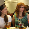 Tenth Triennial Gathering | Andrea Westby, a cafe writer, Minneapolis, Minn., and Kimberly Metzger, Adams, Neb. hang out at the Cafe (Boldcafe.org) dinner.