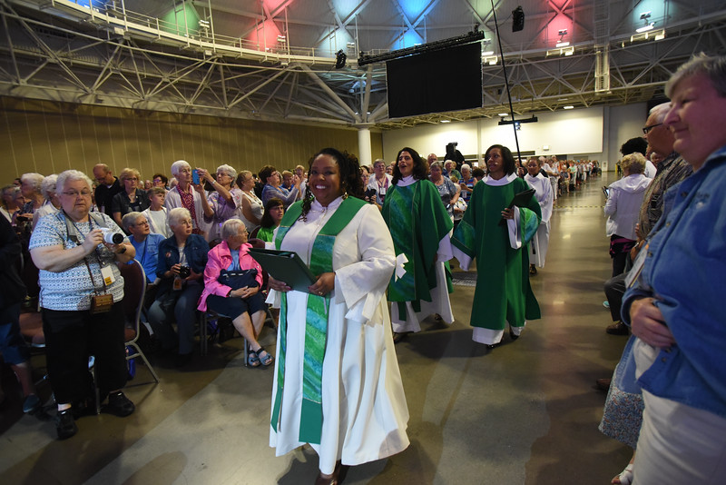 Tenth Triennial Gathering | Rev. Angela Khabeb, Waukesha, Wisc., Ascension Church, leads the procession at closing worship. Followed by Rev. Barbara Lund, presider and Camille Trott, assisting minister.