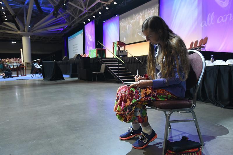 Tenth Triennial Gathering | Artist-in-residence Vonda Dress draws during closing worship.