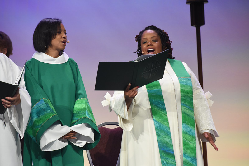 Tenth Triennial Gathering | Camille Trott, Sharpsburg, Ga., assists Rev. Angela Khabeb, Waukesha, Wisc., Ascension Church, in closing worship.
