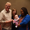 Tenth Triennial Gathering | Aaron Marshall, Elizabeth McBride pose with Leymah Gbowee and their daughter, Eilis.
