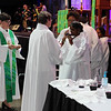 Tenth Triennial Gathering | Communion assistants receiving communion at opening worship.