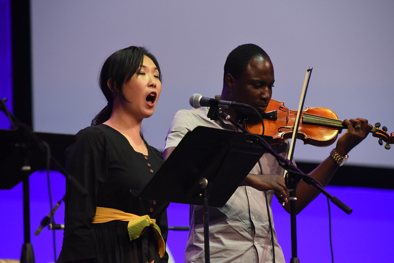 "Tenth Triennial Gathering | Momoko Tanno, Minneapolis, Minn., sang while Ernest Bisong, Minneapolis, Minn., played the violin during the hymn, ""Come to Me All Pilgrims Thirsty."""