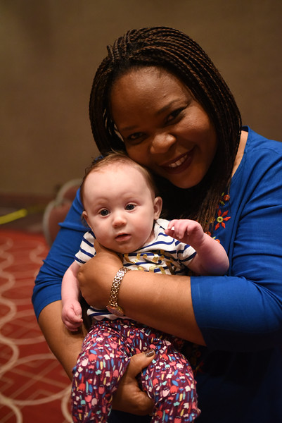Tenth Triennial Gathering | Leymah Gbowee poses with Eilis Marshall, 5 months. Eilis is one of the youngest participants at the event.