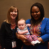 Tenth Triennial Gathering | Elizabeth McBride, Women of the ELCA staff, poses with Leymah Gbowee and her daughter, Eilis Marshall.
