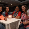 Tenth Triennial Gathering | Aysha Espinosa, Cayey, Puerto Rico, Sion, Bayamon, Nayoline Espinosa, Clermont, Fla., Sion Bayamon and Kristen Andrews, Nazareth, PA, St. John's enjoy good conversation at the Lounge.