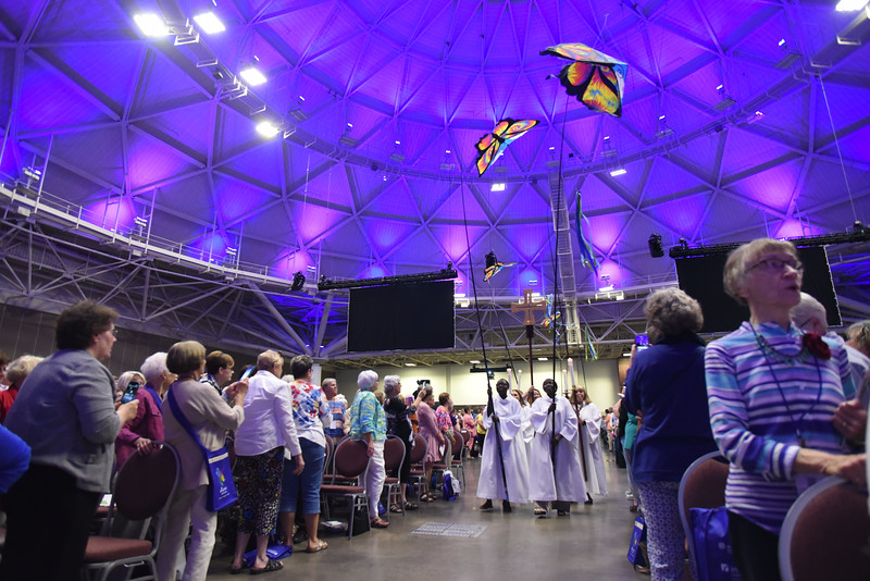 Tenth Triennial Gathering | Processional with butterfly banners at the beginning of the opening Thankoffering service.