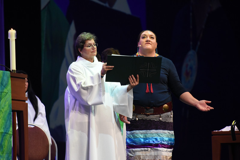 Tenth Triennial Gathering | BethAnn Lynch, Chicago, worship staff, ELCA, and Prarie Rose Seminole, American Indian Alaska Native Ministries, ELCA, prays during the opening worship.