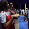 Tenth Triennial Gathering | Communion assistants prepare for communion.