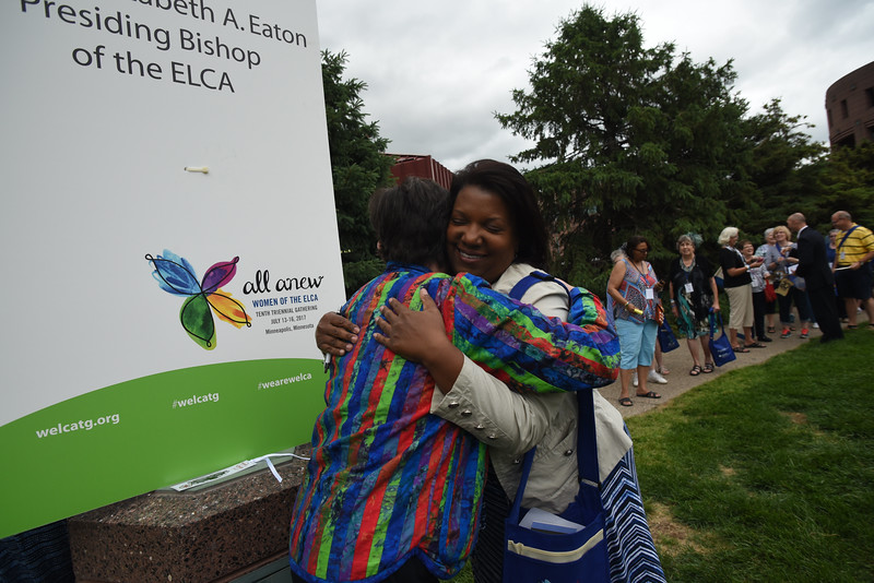 """Tenth Triennial Gathering   First time attendee, Candace Eubanks, Milwaukee, Wisc. embraces Bishop Eaton at """"Meet the bishop"""" at the opening reception."""