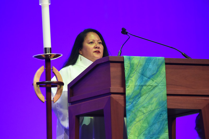 Tenth Triennial Gathering   Tina Bigelow gives the second reading from Titus 3:4-7 at opening worship.