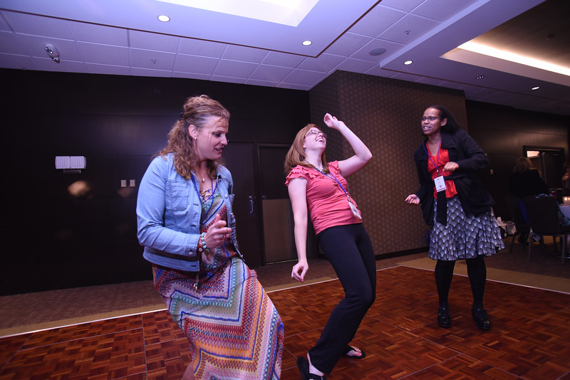 Tenth Triennial Gathering | Sara Larson, Balaton, Minn., Kimberly Metzger, Adams, Neb. and Elizabeth Hunter, Women of the ELCA staff, dance to their favorite music from the 80s and 90s at Lounge '70, '80, '90.