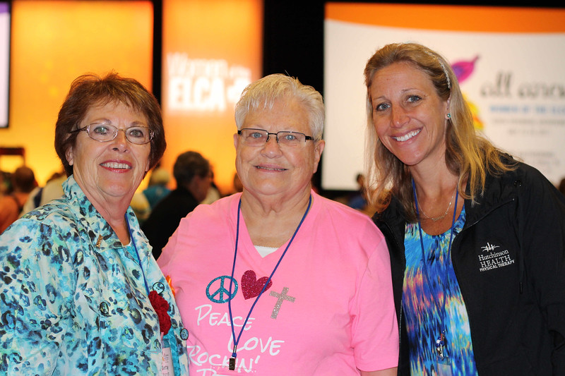 Tenth Triennial Gathering | Betty Brandt, left, and her daughter, Ann Kosel, right, Hutchinson, Minn., pose with Beth Meyer, Fremont, Neb., during opening worship.