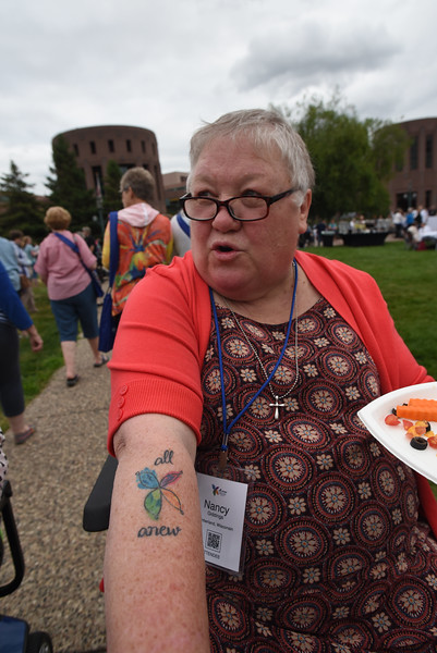 "Tenth Triennial Gathering | Nancy Giddings shows off her ""All Anew"" tattoo."