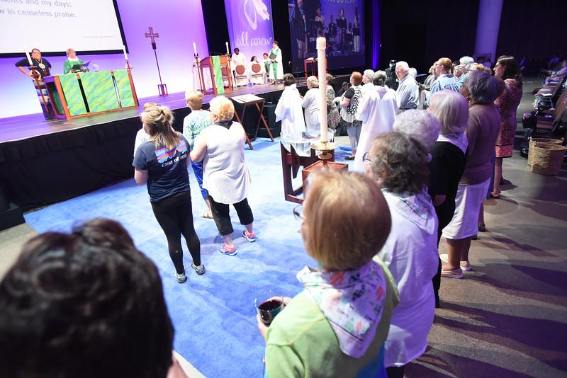 Tenth Triennial Gathering | Communion assistants prepare for communion.