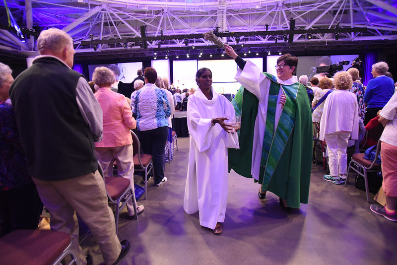 Tenth Triennial Gathering | Bishop Eaton sprinkles holy water during the during opening ceremony.